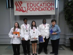 Students Jacquita Jolley, Julia LaSalle, Edna Phares and Chantal Quillen were led by Patricia Johnson. They had 60 minutes to complete a three-course meal for the hungry judges, while jealous spectators simply watched.