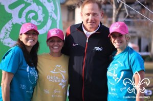 Wahlborg, center, and Bloss, right, pose at the Girls on the Run spring 5k with LSU Coach Les Miles.