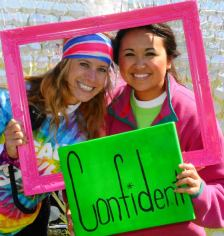 Bloss poses with a friend at a Girls on the Run promotional event.