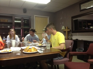 Adam Roethele, LSU senior with a major in kinesiology, serves on the leadership team for the Refuge college service.  Every Thursday night the team meets to have a meal and prepare for the following week.